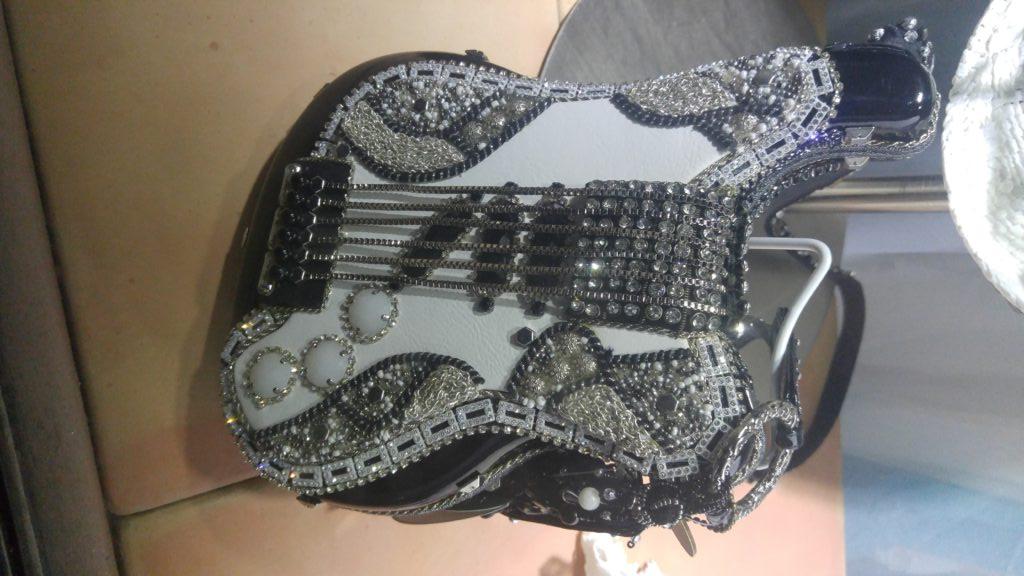 Guitar purse for sale in Santa Fe window